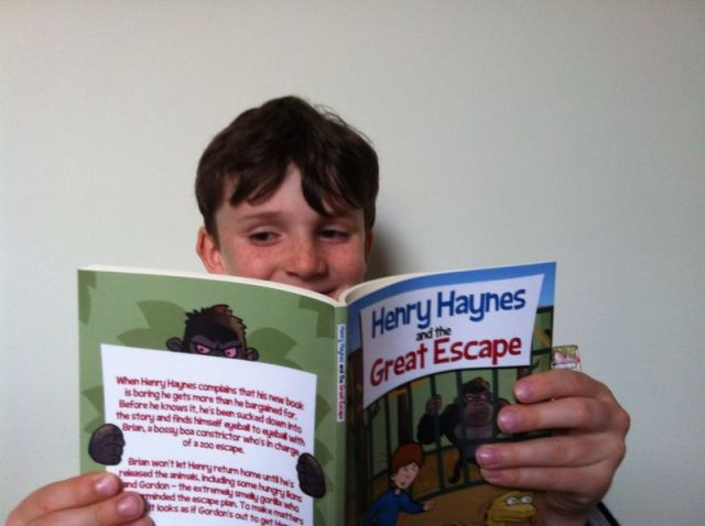 Image of boy reading Henry Haynes and the Great Escape