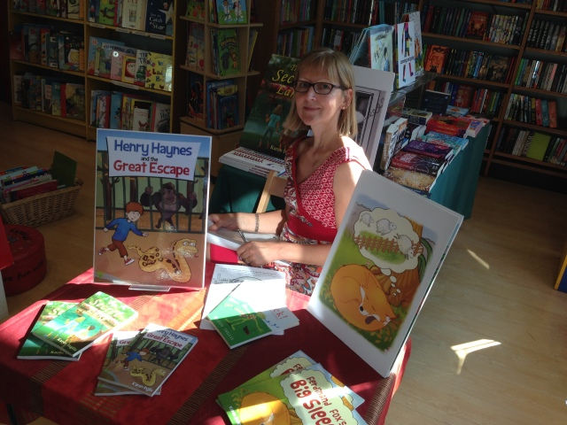 Image of children's author Karen Inglis sitting at signing table at Wimbledon Bookshop
