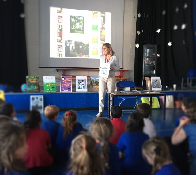 Image of author Karen Inglis speaking to children at a school author event