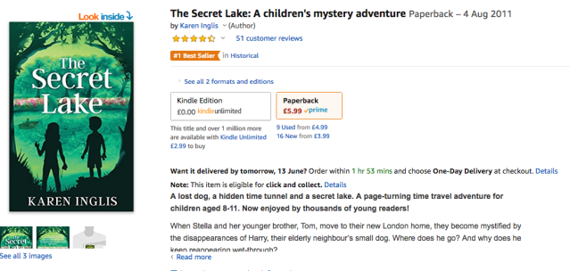 image of front cover of The Secret Lake by Karen Inglis - two children standing by a pond looking at a boy in a boat