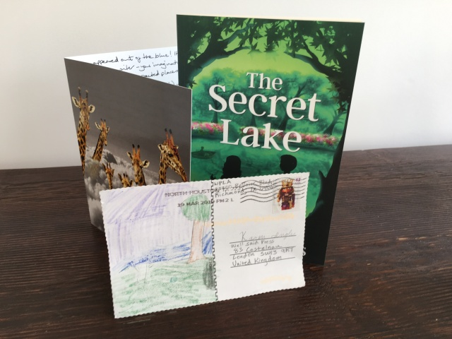 image of a book and two cards