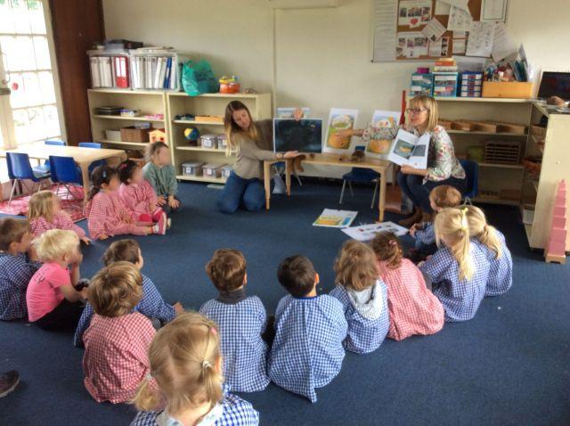 Children's Author Karen Inglis reading Ferdinand Fox and the Hedgehog to the pupils of Barnes Montessori