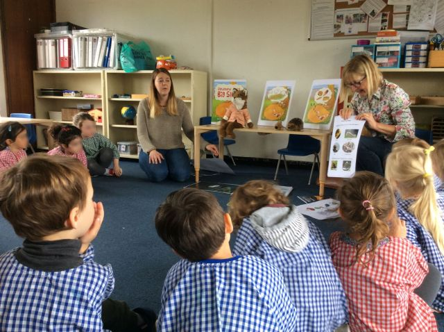 Karen Inglis at front of class with nursery pupils at Barnes Montessori