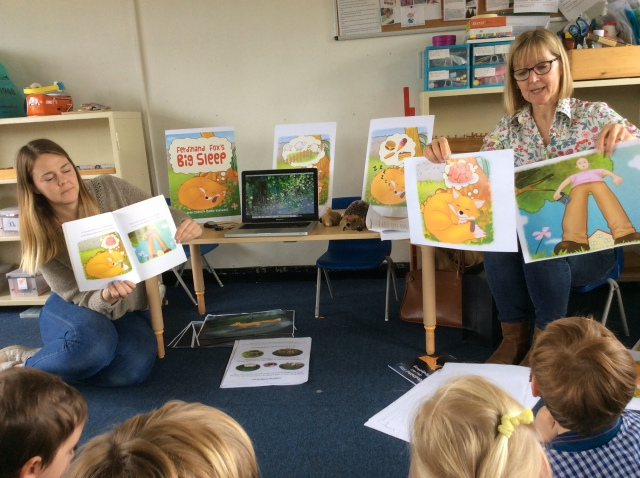 Author and teacher with pupils - picture book reading